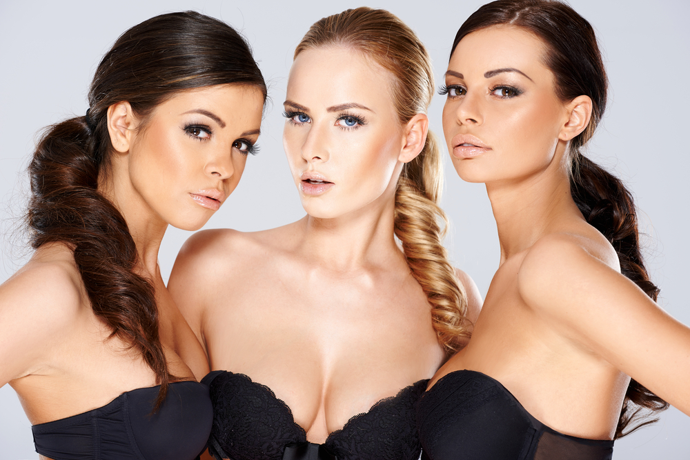 Three_sensual_beautiful_beguiling_women_wearing_black_lingerie_looking_seductively_by_Daniel_Dash_unter_Verwendung_Lizenz_Shutterstock.com