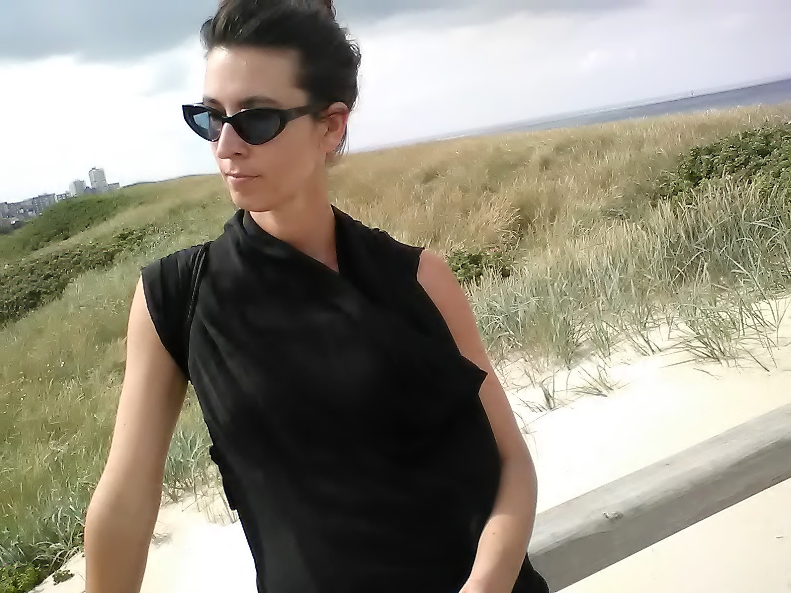 Young, fashionable woman walking down Sylt Beach