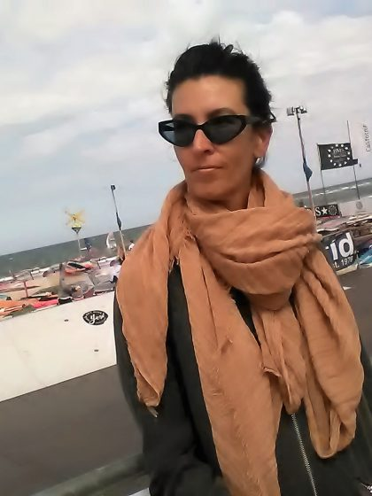 Fashionable, young woman posing at Sylt Beach.